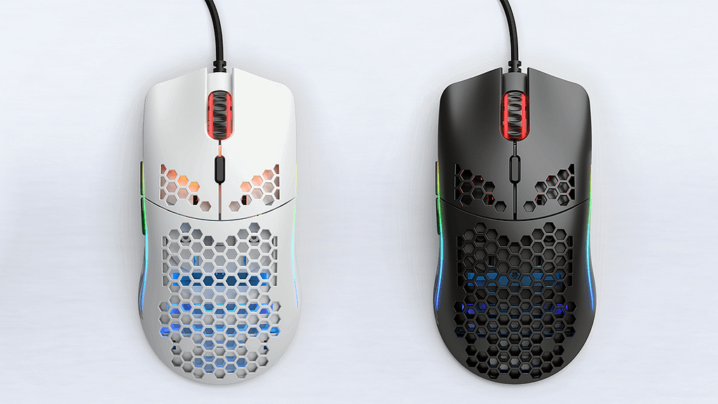 A pair of black and white Glorious Model O mice lit by neon sides