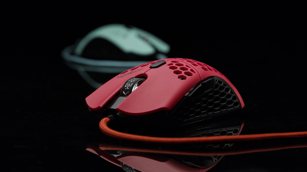 Red Final Mouse Air58 closeup with out of focus green mouse in background
