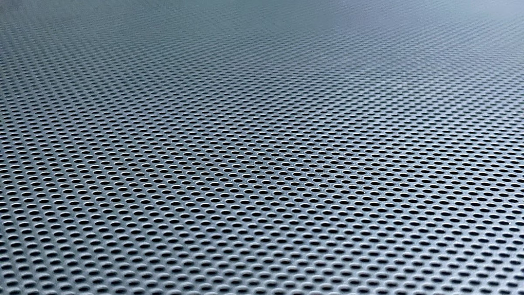 Close up of one black Formd T1 mesh side panel with fading look like a honeycomb lattice