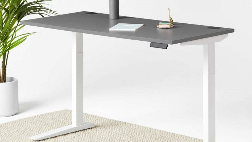 A white Jarvis sit-stand desk against a white background with grey countertop
