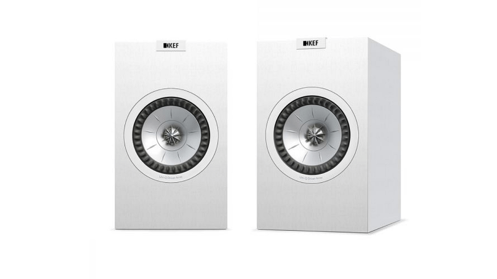 A pair of white Q150 KEF Bookshelf speakers against a plain background