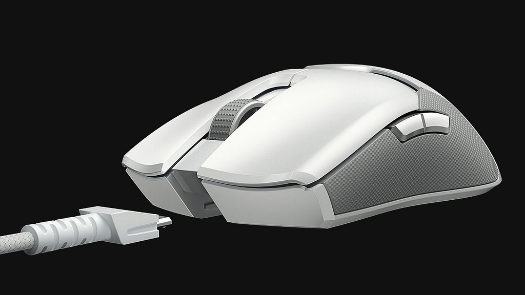 Front corner of the Mercury color Razer Viper Ultimate Gaming Mouse showing side programmable buttons and detachable USB cable
