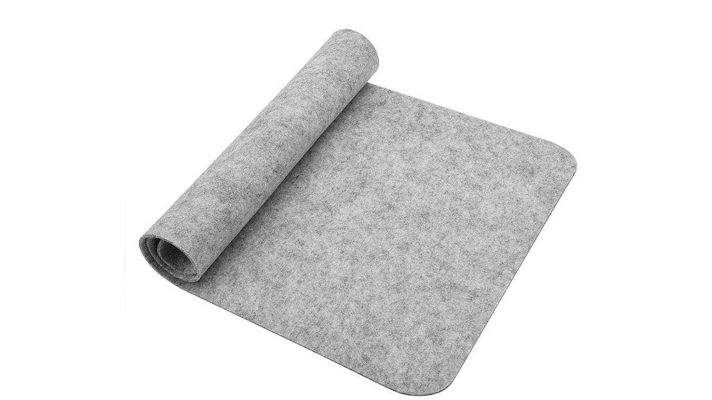 A large grey Richer Mouse Pad half rolled up against a clear background