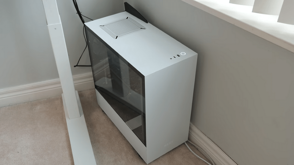 A white NZXT H510 computer case completing the minimalist home office design