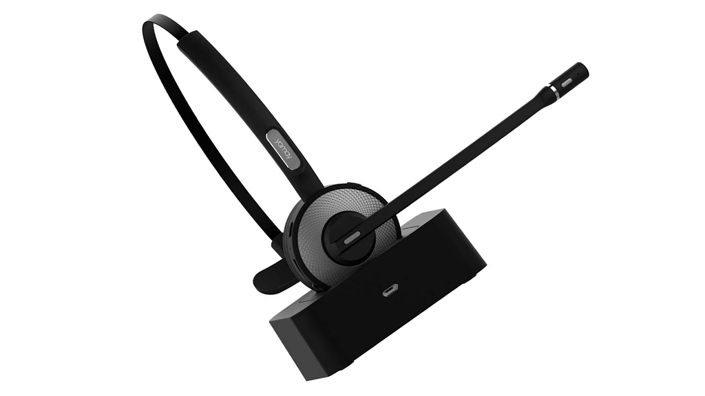 YAMAY Bluetooth headset M98 in chargin dock against a white background; our pick for the best office headset.