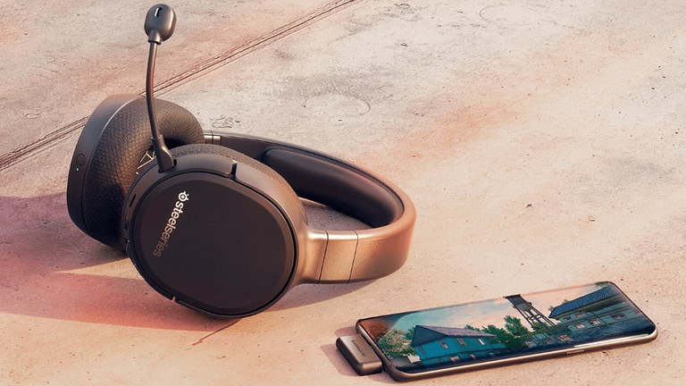 The best budget wireless gaming headset sitting against concrete with Fortnight in the foreground